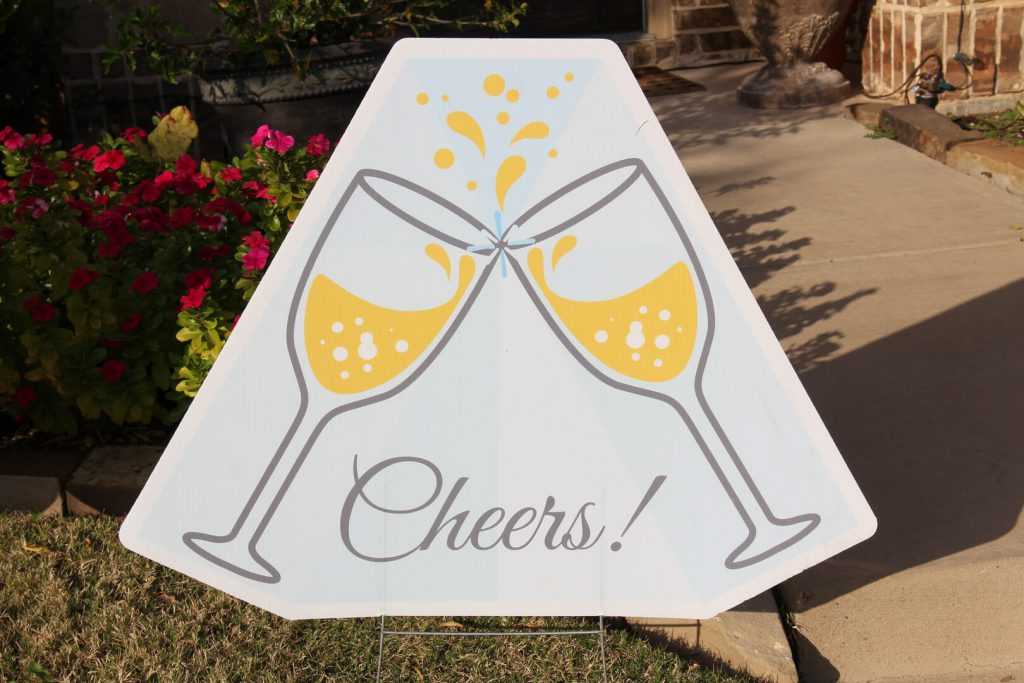Graphic of champagne glass toast