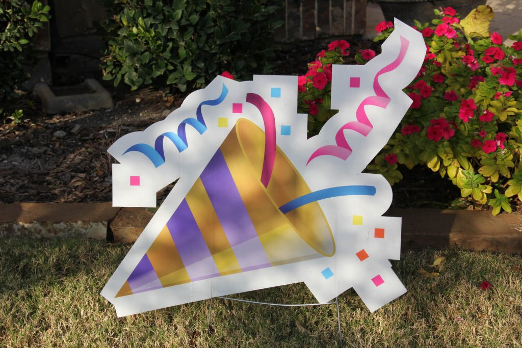 yard sign of party hat