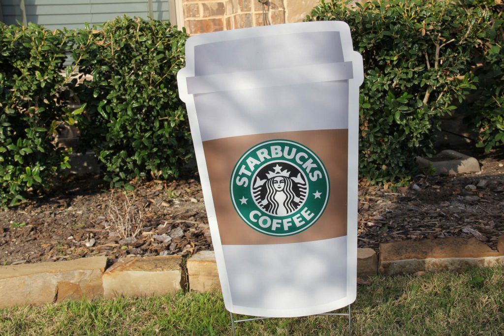 yard sign of Starbucks cup