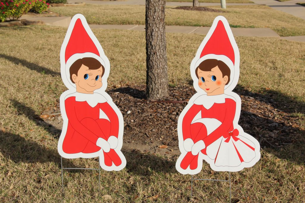 lawn signs of Christmas elves