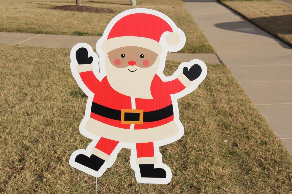 yard sign of Santa Claus