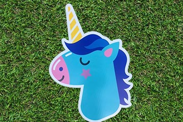 Plastic lawn graphic of a unicorn head