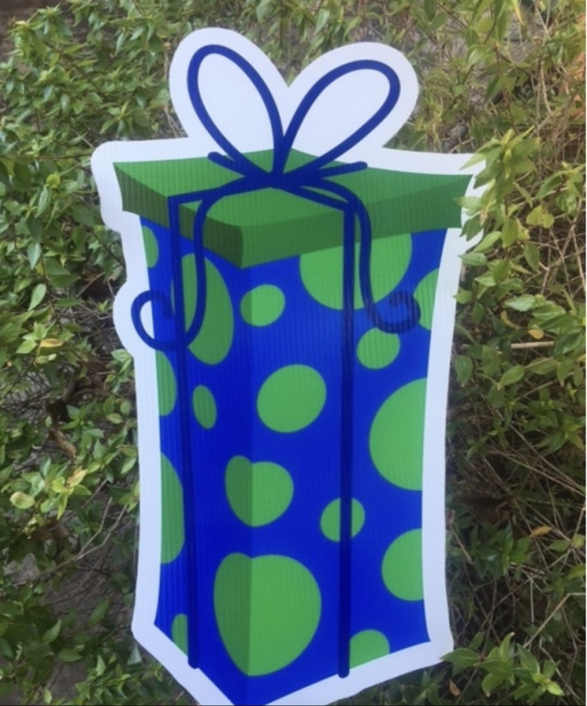 yard sign with polka dot gift box