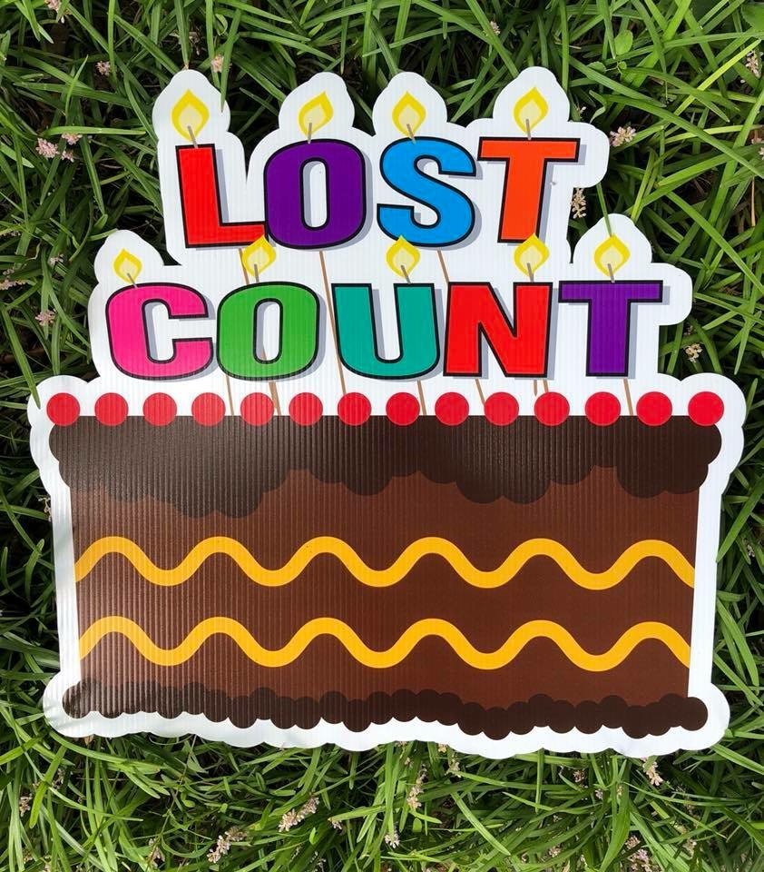 lawn graphic of lost count birthday cake