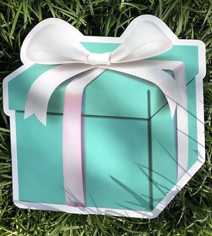 yard sign of gift box