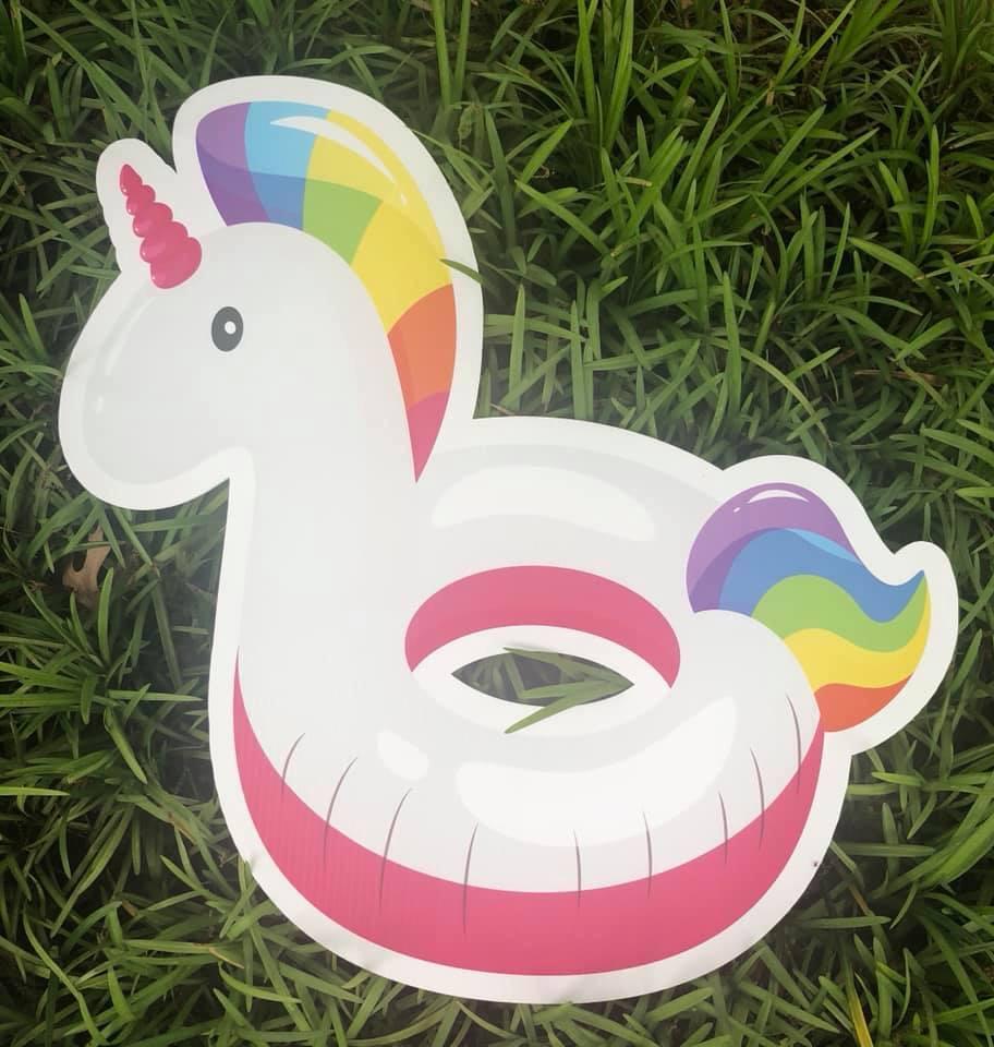 yard sign of unicorn pool inflatable