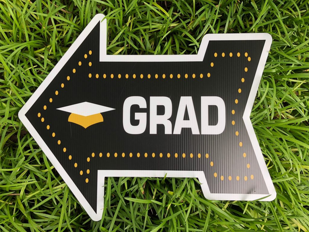yard sign of grad arrow