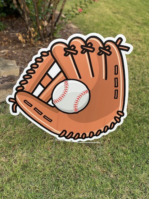 A baseball glove with a baseball in it