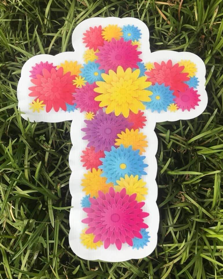 blue, yellow, red, pink and purple flowers in the shape of a cross