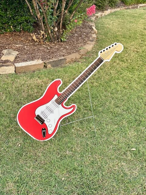 A red guitar like a Fender Stratocaster