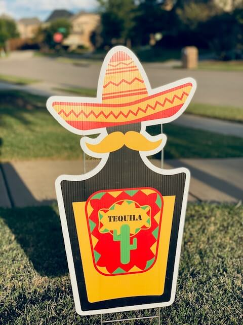 A bottle of tequila with a sombrero on it