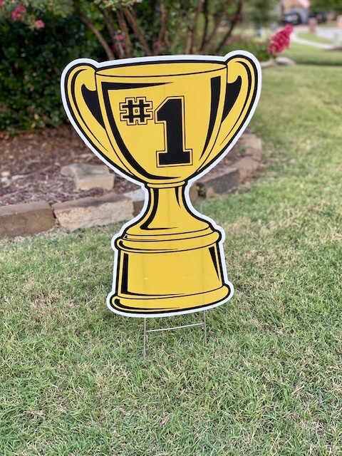 A gold trophy cup with #1 on it