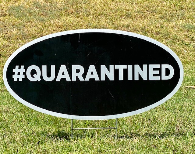 A black oval with the hashtag #quarantined