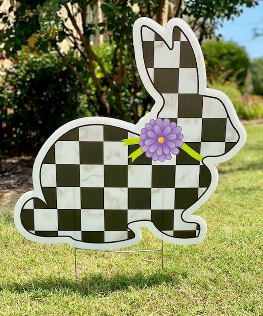 A black and white checkerboard bunny