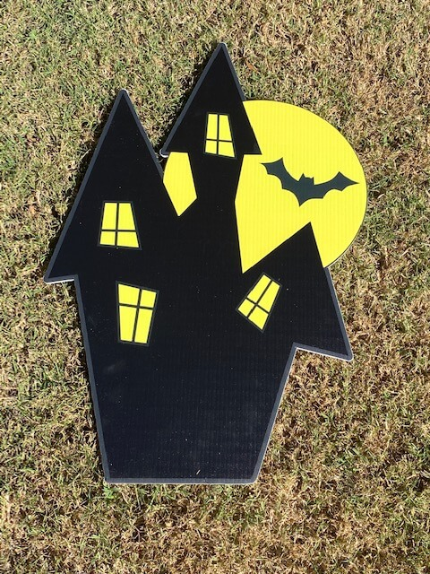A haunted house with bat in the moon