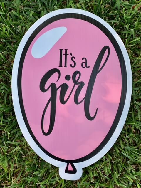 "A pink balloon with the words ""It's a girl!"""