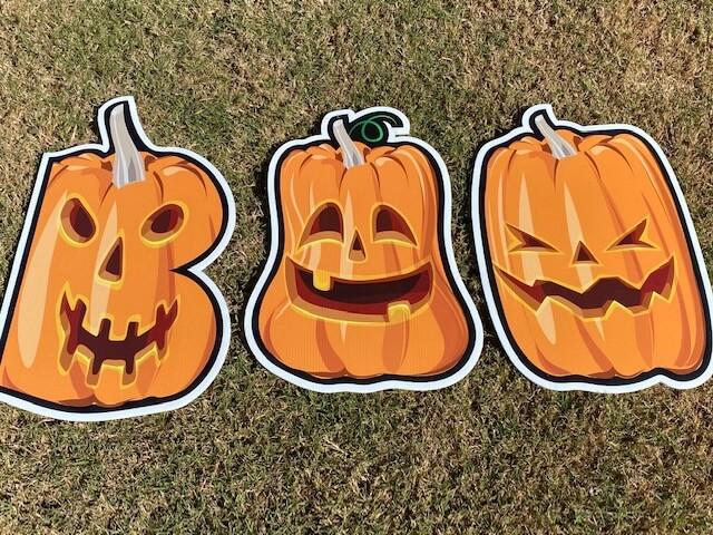 Three jack-o-lanterns that spell BOO