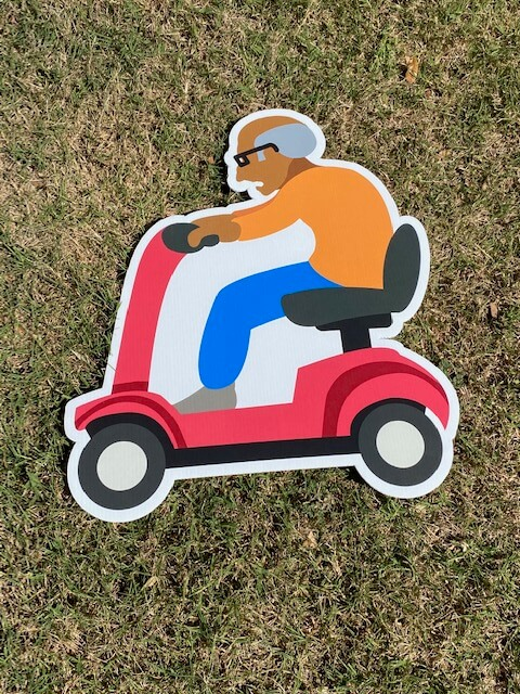 an old man driving a scooter