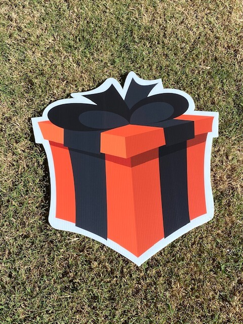 An orange gift box with black bow