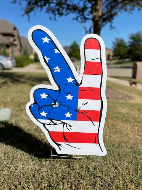 A peace sign fingers with american flag colors
