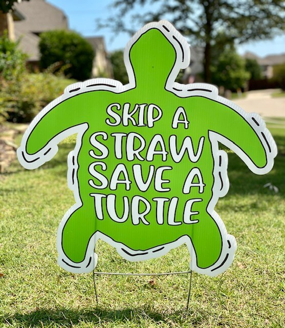 "A green sea turtle with the words ""Skip a straw save a turtle"""