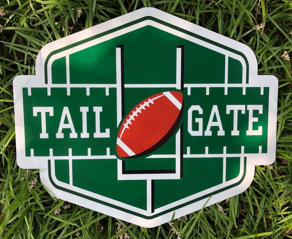 a football field, goal post with the words tail gate