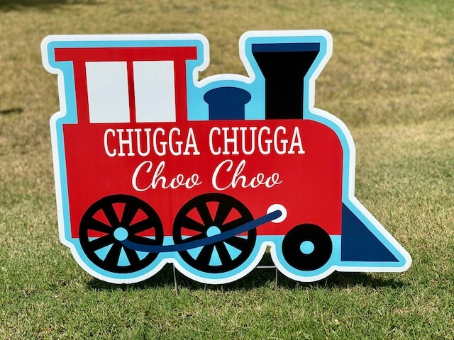 "A childs train with the words ""Chugga Chugga Choo choo"""
