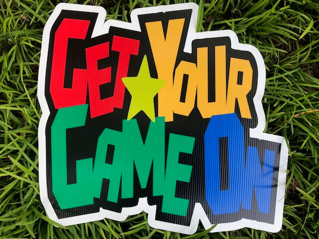 "a sign reading ""Get Your Game On"""
