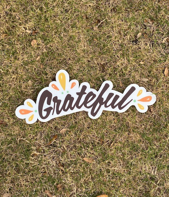"the word ""Grateful"""