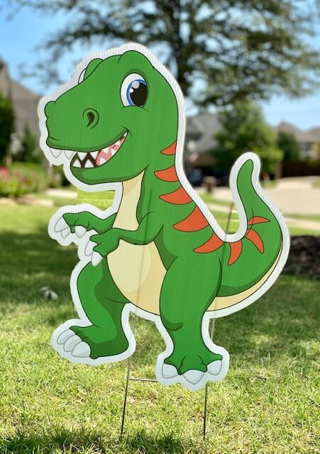 A happy green dinosaur
