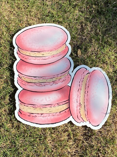 a stack of pink macarons