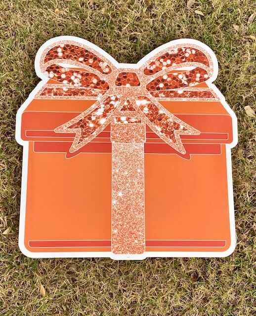 An orange gift box with a bow