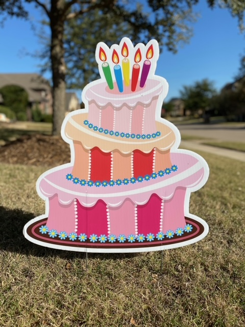 A pink birthday cake
