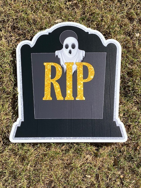 A tombstone with RIP on it