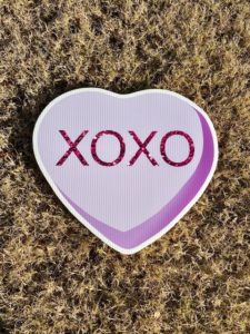 Lavendar Candy Heart with the word XOXO