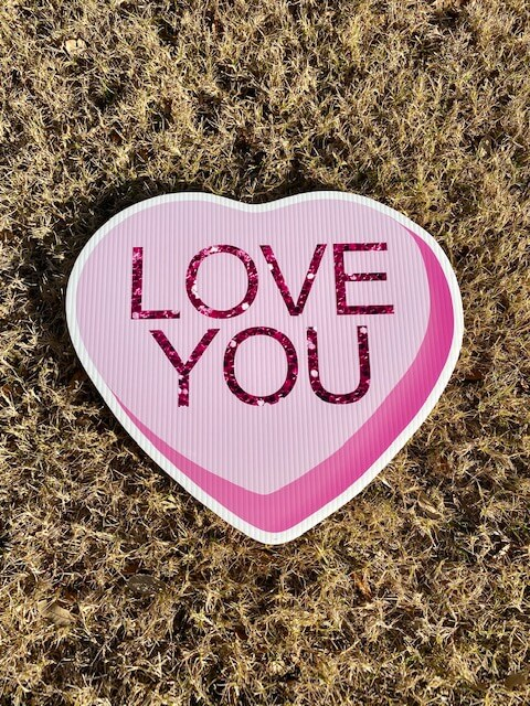 Pink Candy Heart with the words Love You