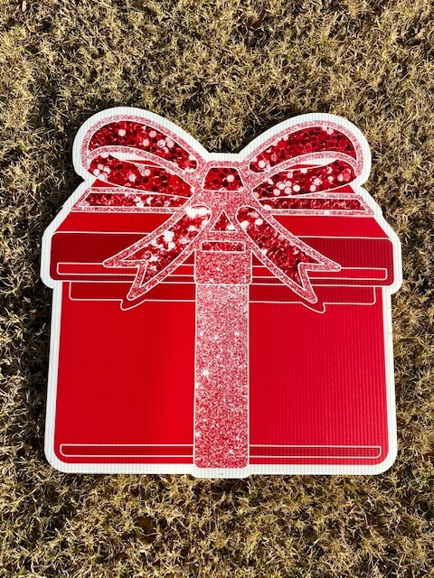 A red gift box with a sparkly red bow