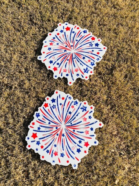 Red, white and blue firework bursts