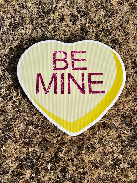 Yellow Candy Heart with the words Be Mine