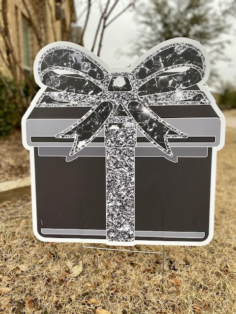 black gift box with a silver sparkly bow