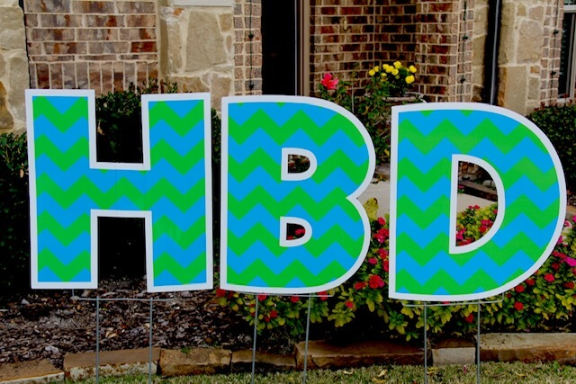 Blue and green zigzag patterned letters
