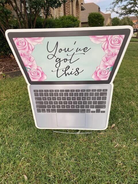 """A laptop with pink roses on the screen and the words """"You've got this"""""""
