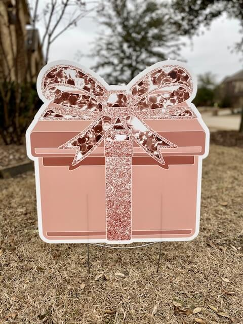 Peach or copper colored gift box with sparkly bow