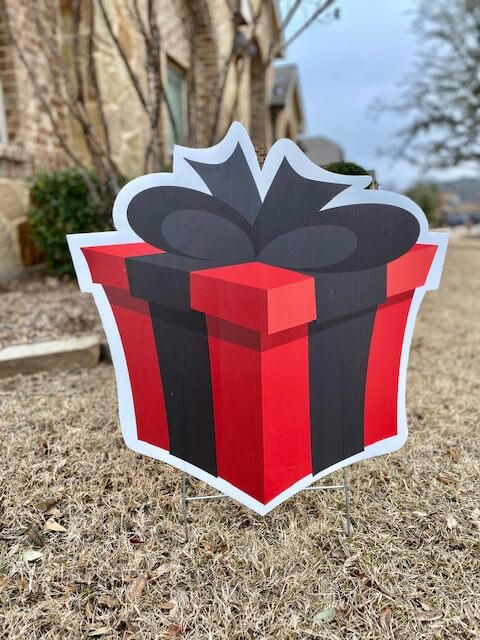 Red gift box with black bow