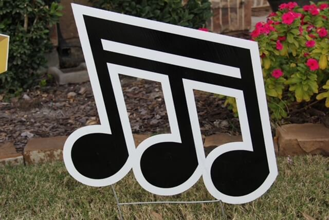 A musical note - an eighth note triplet