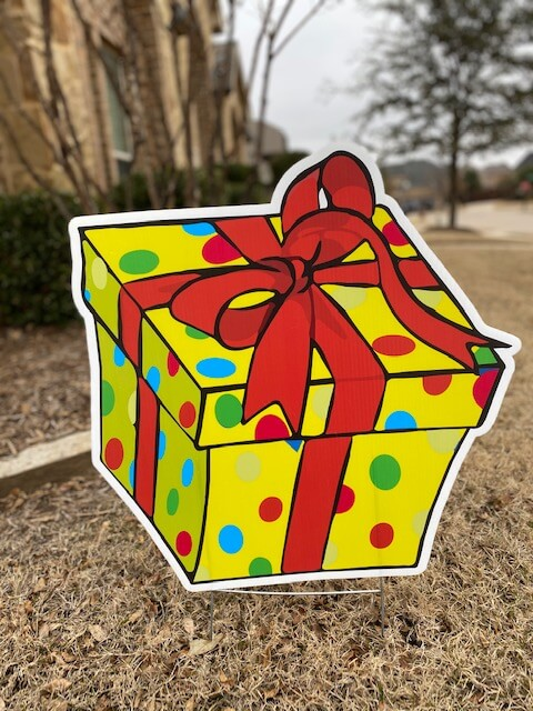 Yellow polka dotted gift box with red bow