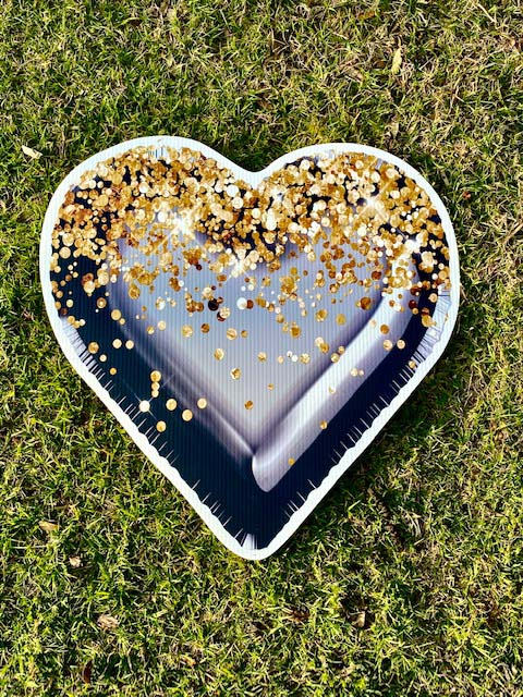Black heart with gold sparkles