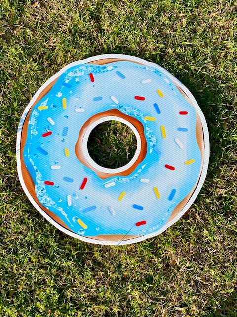 Donut with blue frosting and colored sprinkles