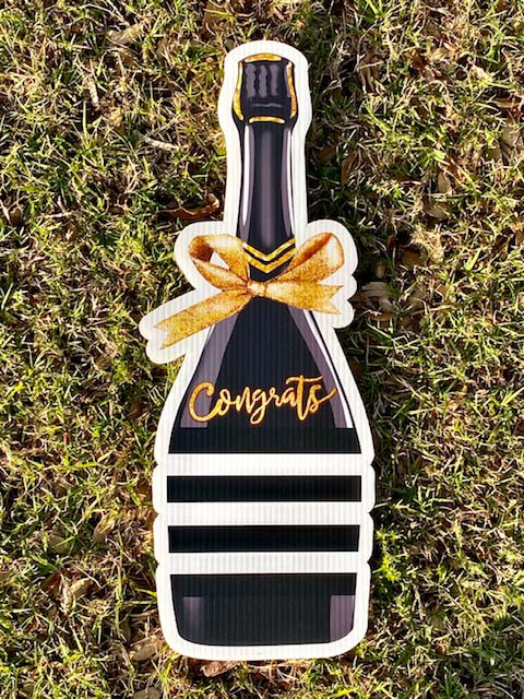 """Black champagne bottle with gold bow and word """"congrats"""""""