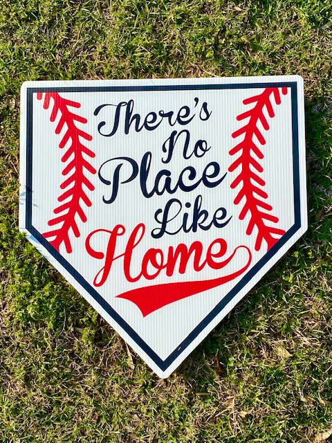 There's no place like home printed on a home plate